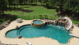 Swimming Pool, Slide, Diving Board, Hot Tub, and Waterfall… What more could yo…