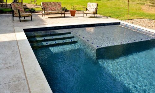 Freeform Pool with Boulder Creations Slide and Moss Rock Waterfall