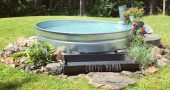 Stock tank swimming pool with salt water system piped back in with an old chicke…